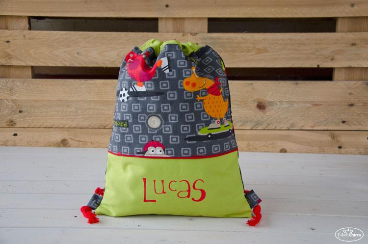 Bolsa-portatodo-dinosaurios-Lucas-apoyada